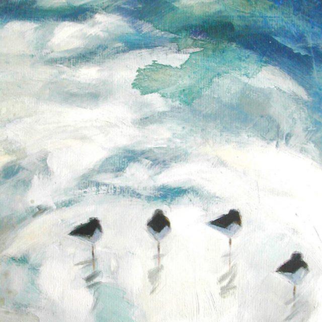 standing birds running tide